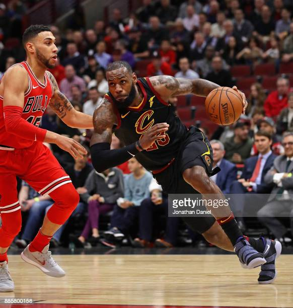 LeBron James of the Cleveland Cavaliers drives against Denzel Valentine of the Chicago Bulls at the United Center on December 4 2017 in Chicago...