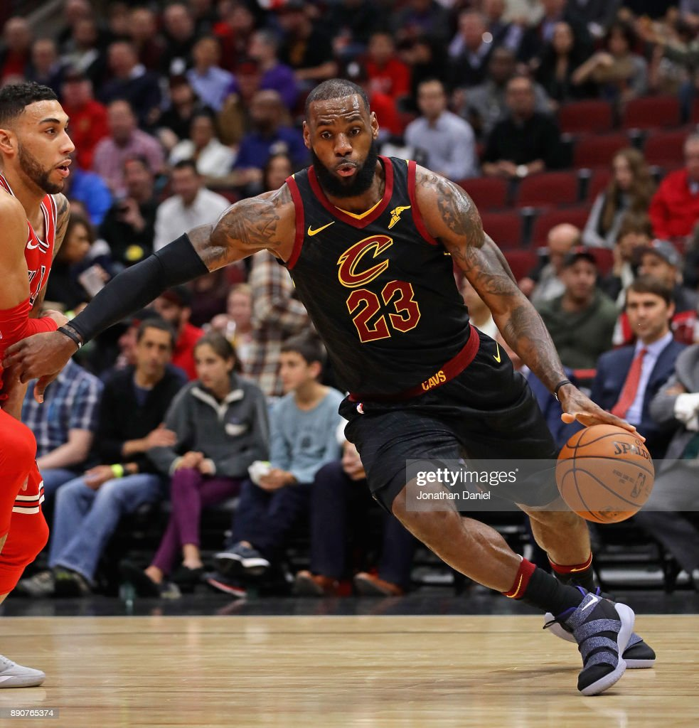 LeBron James #23 of the Cleveland Cavaliers drives against Denzel Valentine #45 of the Chicago Bulls at the United Center on December 4, 2017 in Chicago, Illinois.