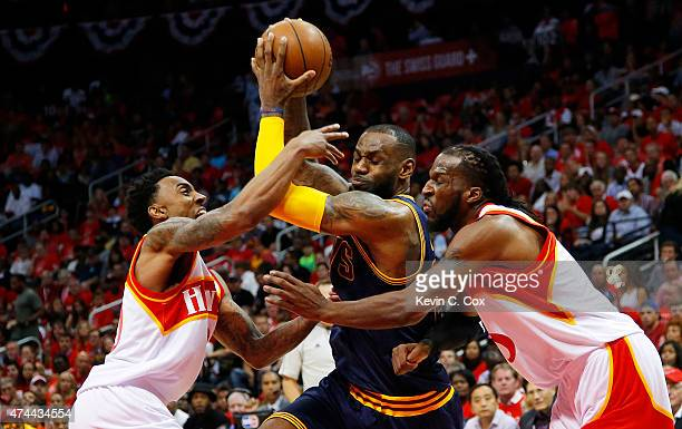 LeBron James of the Cleveland Cavaliers drives against Jeff Teague and DeMarre Carroll of the Atlanta Hawks in the second quarter during Game Two of...