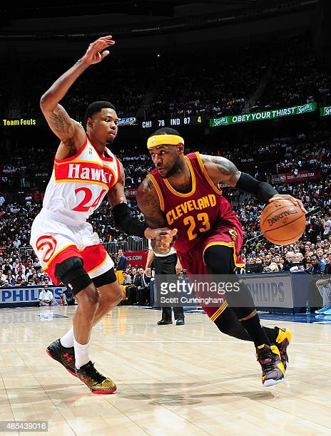 Lebron James of the Cleveland Cavaliers drives against Kent Bazemore of the Atlanta Hawks on March 6 2015 at Philips Arena in Atlanta Georgia NOTE TO...