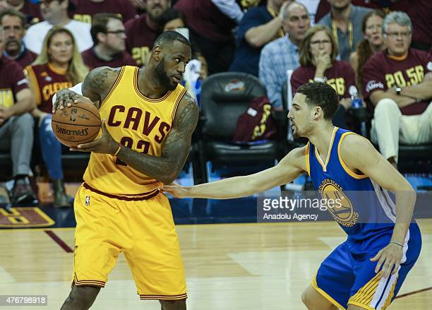 LeBron James of the Cleveland Cavaliers drives against Klay Thompson of the Golden State Warriors during Game Four of the 2015 NBA Finals between the...