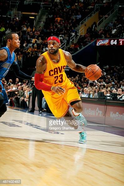 LeBron James of the Cleveland Cavaliers drives against the Dallas Mavericks at The Quicken Loans Arena on October 17 2014 in Cleveland Ohio NOTE TO...