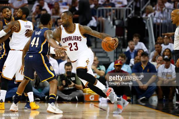LeBron James of the Cleveland Cavaliers drives around Jeff Teague of the Indiana Pacers during the first half in Game Two of the Eastern Conference...