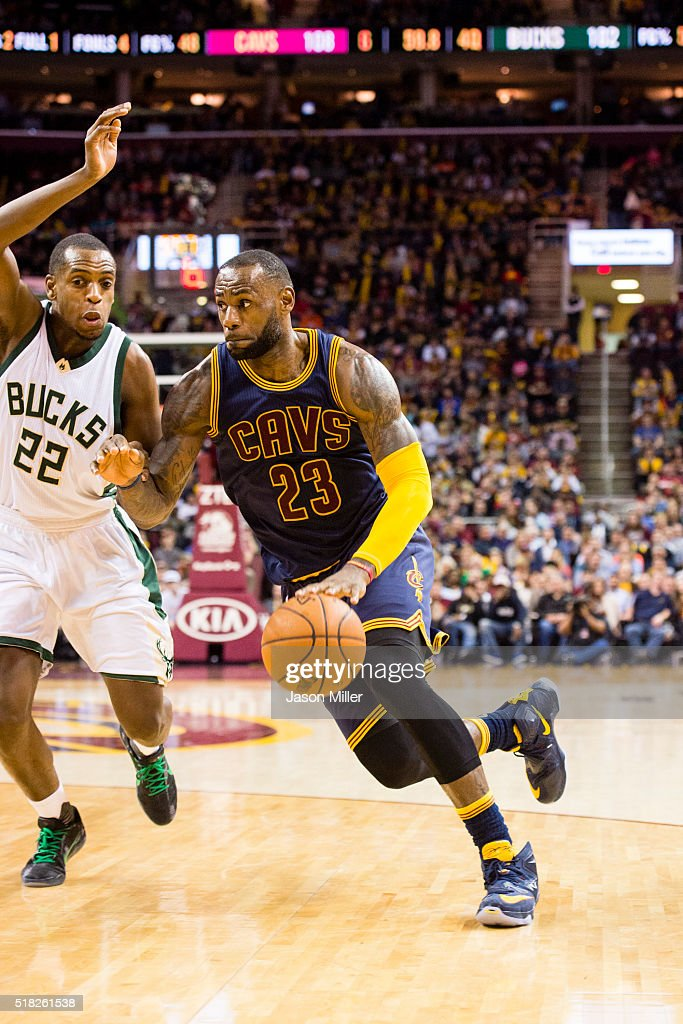 LeBron James of the Cleveland Cavaliers drives around Khris Middleton of the Milwaukee Bucks during the second half at Quicken Loans Arena on March...