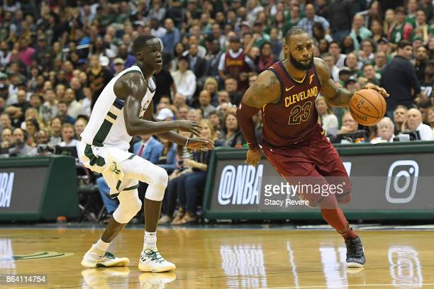 LeBron James of the Cleveland Cavaliers drives around Thon Maker of the Milwaukee Bucks during the second half of a game at the Bradley Center on...