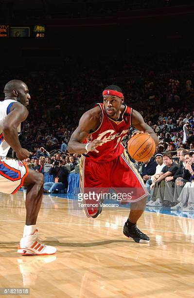LeBron James of the Cleveland Cavaliers drives during the game against the New York Knicks on November 21 2004 at Madison Square Garden in New York...