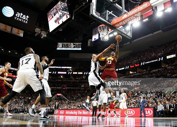 Lebron James of the Cleveland Cavaliers drives on Tim Duncan of the San Antonio Spurs at ATT Center on January 14 2016 in San Antonio Texas NOTE TO...