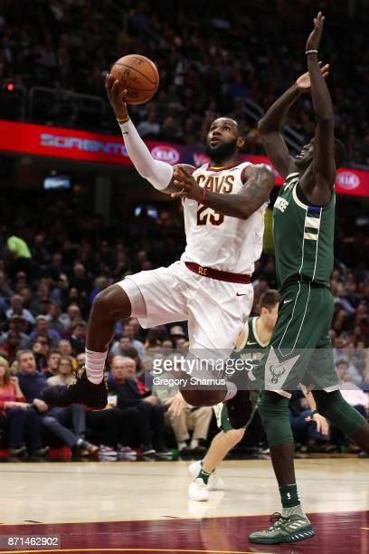 LeBron James of the Cleveland Cavaliers drives past Thon Maker of the Milwaukee Bucks during the second half at Quicken Loans Arena on November 7...