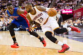LeBron James of the Cleveland Cavaliers drives Reggie Jackson of the Detroit Pistons during the second quarter of the NBA Eastern Conference...
