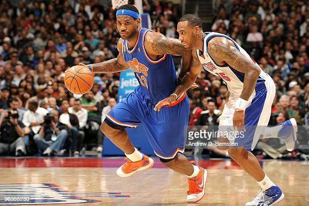 LeBron James of the Cleveland Cavaliers drives the ball around Rasual Butler of the Los Angeles Clippers during the game on January 16 2010 at...