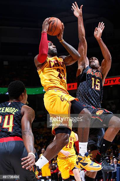 LeBron James of the Cleveland Cavaliers drives to the basket against Al Horford of the Atlanta Hawks in the first half of a preseason game at Cintas...