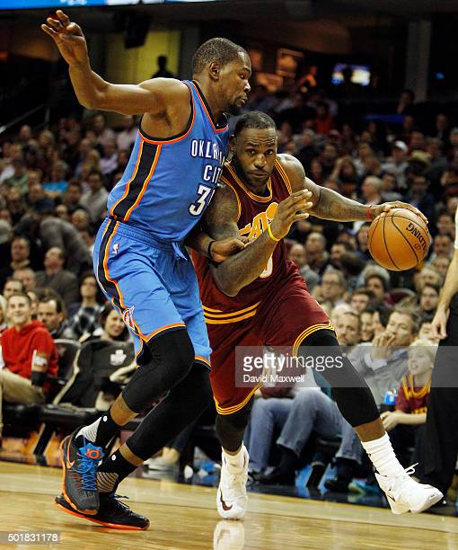 LeBron James of the Cleveland Cavaliers drives to the basket against Kevin Durant of the Oklahoma City Thunder during the second half of their game...