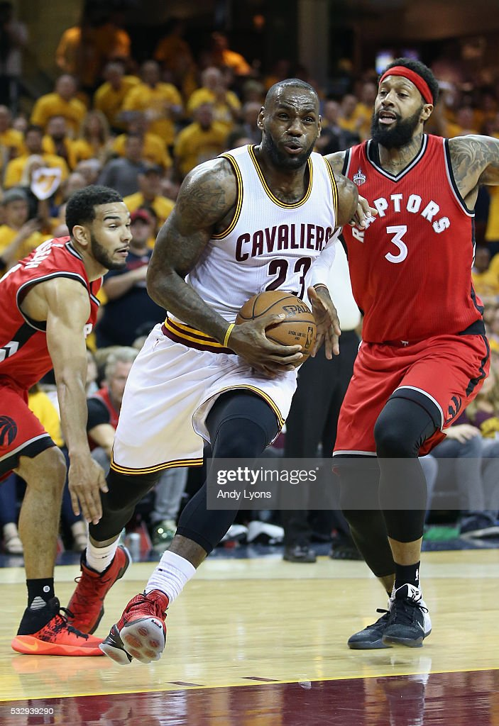 LeBron James #23 of the Cleveland Cavaliers drives to the basket against James Johnson #3 of the Toronto Raptors during the second half in game two of the Eastern Conference Finals during the 2016 NBA Playoffs at Quicken Loans Arena on May 19, 2016 in Cleveland, Ohio.