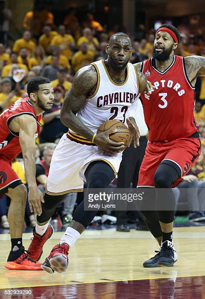 LeBron James of the Cleveland Cavaliers drives to the basket against James Johnson of the Toronto Raptors during the second half in game two of the...