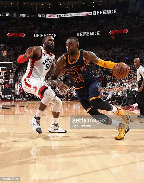 LeBron James of the Cleveland Cavaliers drives to the basket against Patrick Patterson of the Toronto Raptors during Game Four of the Eastern...