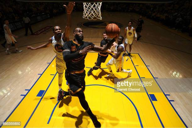 LeBron James of the Cleveland Cavaliers drives to the basket against Kevin Durant of the Golden State Warriors in Game Five of the 2017 NBA Finals on...