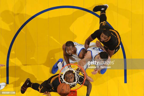 LeBron James of the Cleveland Cavaliers drives to the basket against Kevin Durant and Zaza Pachulia of the Golden State Warriors in Game Five of the...