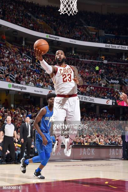 LeBron James of the Cleveland Cavaliers drives to the basket against the Orlando Magic on October 21 2017 at Quicken Loans Arena in Cleveland Ohio...