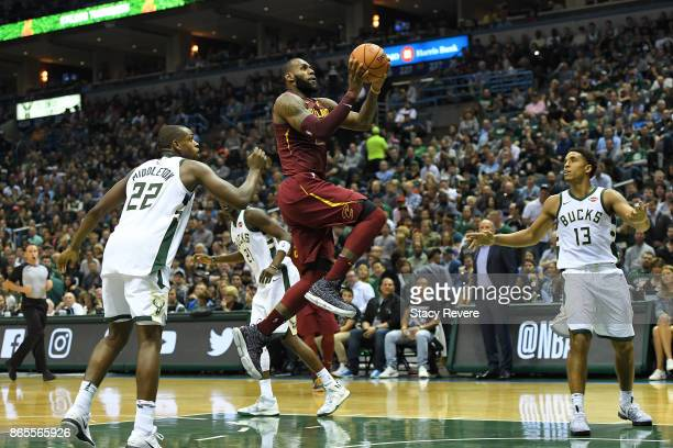 LeBron James of the Cleveland Cavaliers drives to the basket against the Milwaukee Bucks at the Bradley Center on October 20 2017 in Milwaukee...