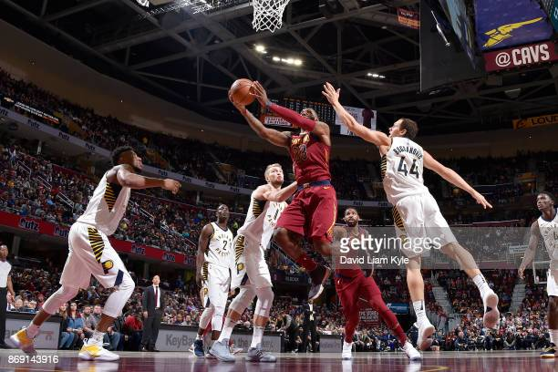 LeBron James of the Cleveland Cavaliers drives to the basket against the Indiana Pacers on November 1 2017 at Quicken Loans Arena in Cleveland Ohio...