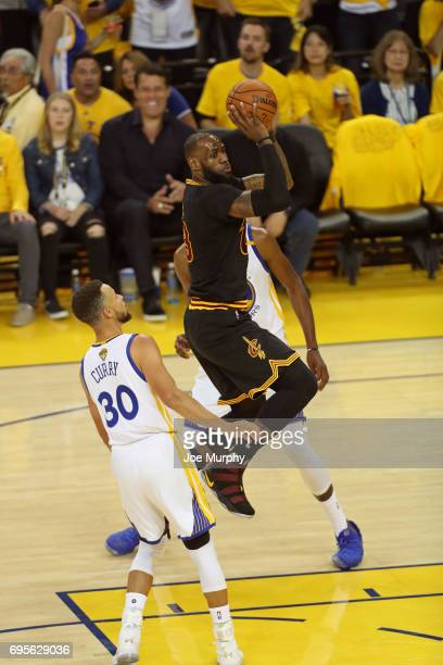 LeBron James of the Cleveland Cavaliers drives to the basket and passes the ball against the Golden State Warriors in Game Five of the 2017 NBA...