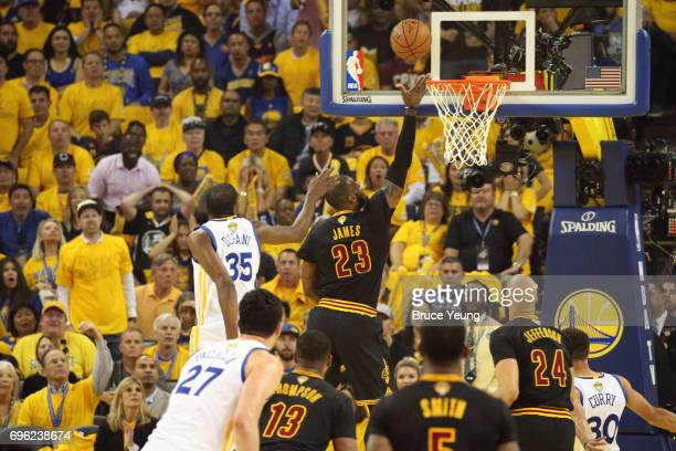 LeBron James of the Cleveland Cavaliers drives to the basket around Kevin Durant of the Golden State Warriors in Game Five of the 2017 NBA Finals on...