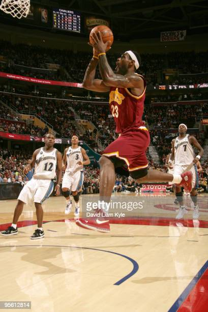 LeBron James of the Cleveland Cavaliers drives to the basket as Earl Boykins Caron Butler and Andray Blatche of the Washington Wizards look on on...