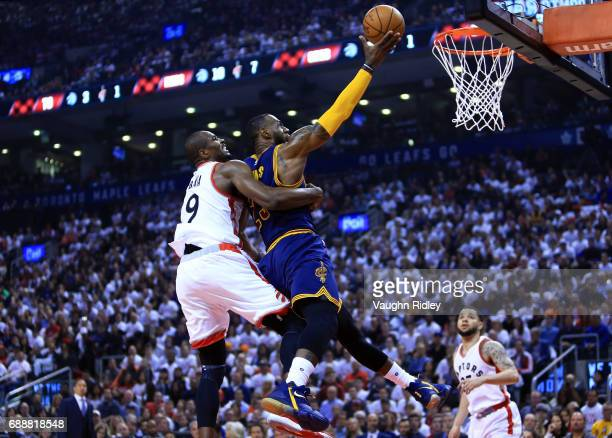 Lebron James of the Cleveland Cavaliers drives to the basket as Serge Ibaka of the Toronto Raptors defends in the first half of Game Four of the...