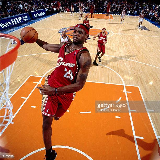 LeBron James of the Cleveland Cavaliers drives to the basket for a dunk against the New York Knicks on April 14 2004 at Madison Square Garden in New...