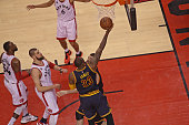 LeBron James of the Cleveland Cavaliers drives to the basket in Game Six of the NBA Eastern Conference Finals against the Toronto Raptors at Air...