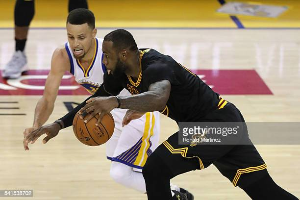 LeBron James of the Cleveland Cavaliers drives with the ball against Stephen Curry of the Golden State Warriors in Game 7 of the 2016 NBA Finals at...