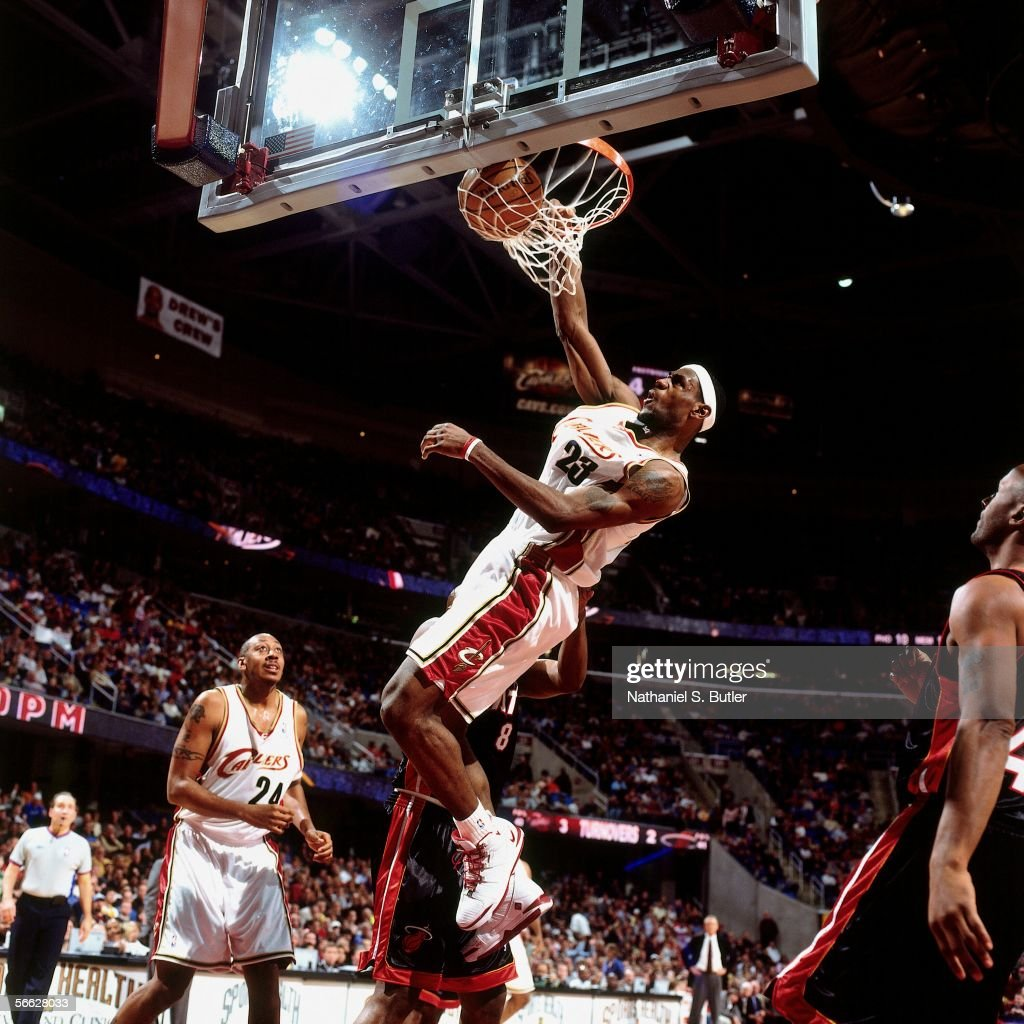 LeBron James #23 of the Cleveland Cavaliers dunks against Antonie Walker #8 of the Miami Heat on December 17, 2005 at Quicken Loans Arena in Cleveland, Ohio.