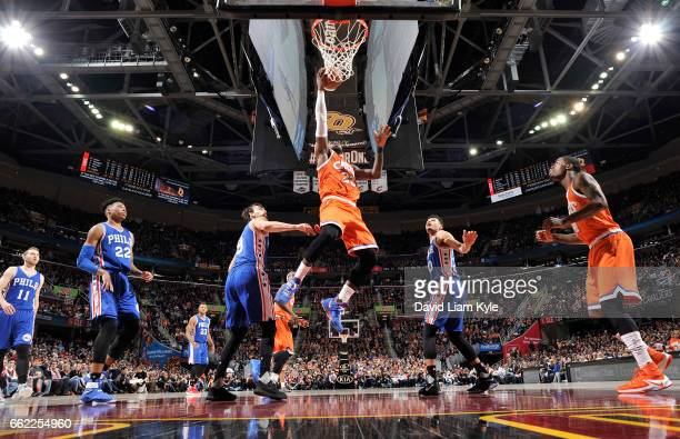 LeBron James of the Cleveland Cavaliers dunks against the Philadelphia 76ers during the game on March 31 2017 at Quicken Loans Arena in Cleveland...
