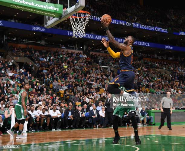 LeBron James of the Cleveland Cavaliers dunks against the Boston Celtics during the game on April 5 2017 at the TD Garden in Boston Massachusetts...