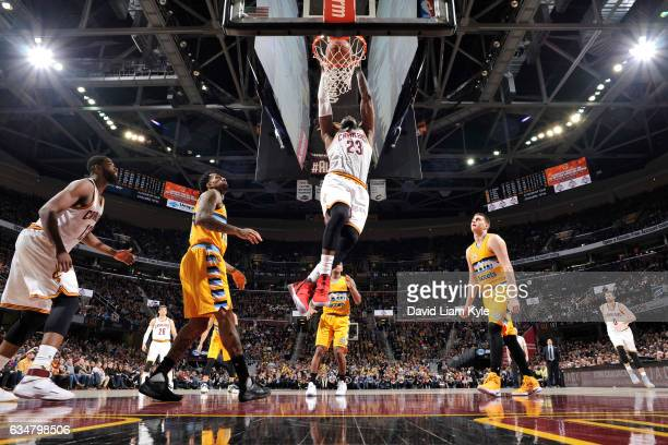 LeBron James of the Cleveland Cavaliers dunks against the Denver Nuggets on February 11 2017 at Quicken Loans Arena in Cleveland Ohio NOTE TO USER...