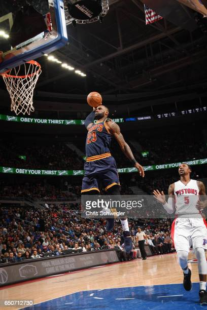 LeBron James of the Cleveland Cavaliers dunks against the Detroit Pistons during the game on March 9 2017 at The Palace of Auburn Hills in Auburn...