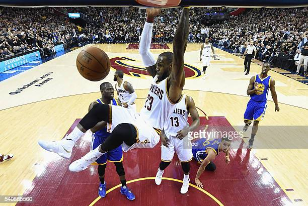 LeBron James of the Cleveland Cavaliers dunks against the Golden State Warriors in Game 6 of the 2016 NBA Finals at Quicken Loans Arena on June 16...