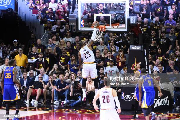 LeBron James of the Cleveland Cavaliers dunks against the Golden State Warriors in Game Three of the 2017 NBA Finals on June 7 2017 at Quicken Loans...