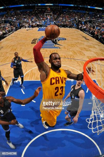 LeBron James of the Cleveland Cavaliers dunks against the Orlando Magic during the game on March 11 2017 at Amway Center in Orlando Florida NOTE TO...