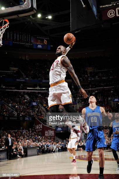 LeBron James of the Cleveland Cavaliers dunks against the Orlando Magic during the game on April 4 2017 at Quicken Loans Arena in Cleveland Ohio NOTE...