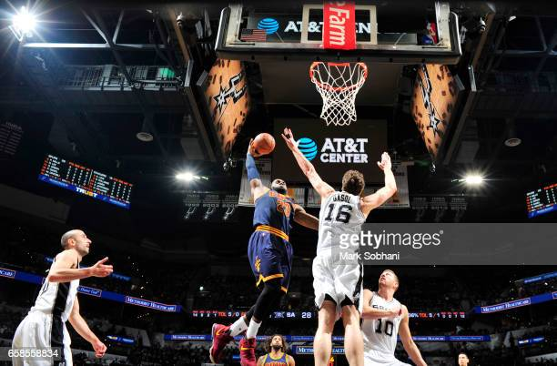 LeBron James of the Cleveland Cavaliers dunks against the San Antonio Spurs during the game on March 27 2017 at the ATT Center in San Antonio Texas...