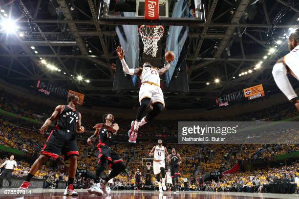 LeBron James of the Cleveland Cavaliers dunks against the Toronto Raptors in Game One of the Eastern Conference Semifinals of the 2017 NBA Playoffs...