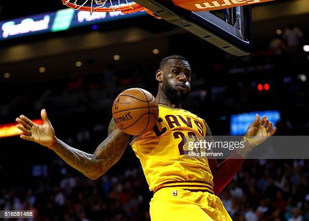 LeBron James of the Cleveland Cavaliers dunks during a game against the Miami Heat at American Airlines Arena on March 19 2016 in Miami Florida NOTE...