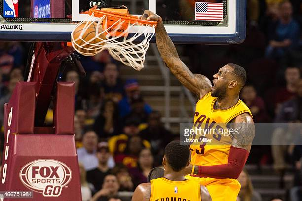 LeBron James of the Cleveland Cavaliers dunks during the first half against the Brooklyn Nets at Quicken Loans Arena on March 18 2015 in Cleveland...