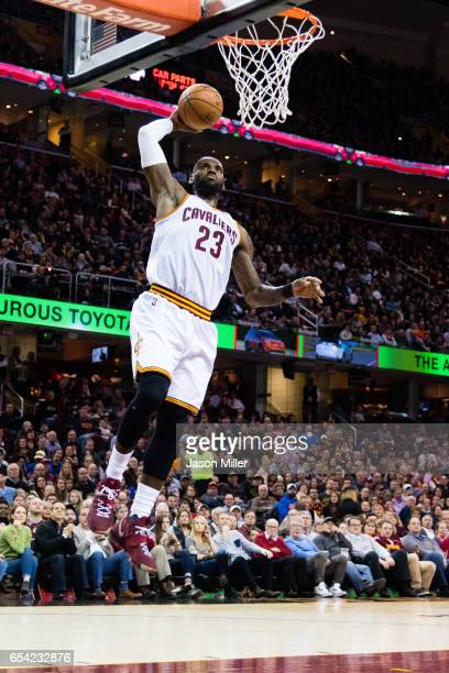 LeBron James of the Cleveland Cavaliers dunks during the first half against the Utah Jazz at Quicken Loans Arena on March 16 2017 in Cleveland Ohio...