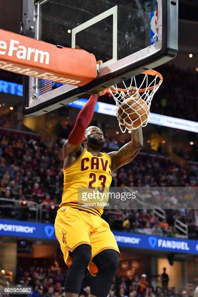LeBron James of the Cleveland Cavaliers dunks during the first half against the Atlanta Hawks at Quicken Loans Arena on April 7 2017 in Cleveland...