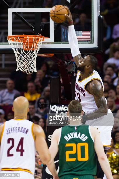 LeBron James of the Cleveland Cavaliers dunks during the second half against the Utah Jazz at Quicken Loans Arena on March 16 2017 in Cleveland Ohio...