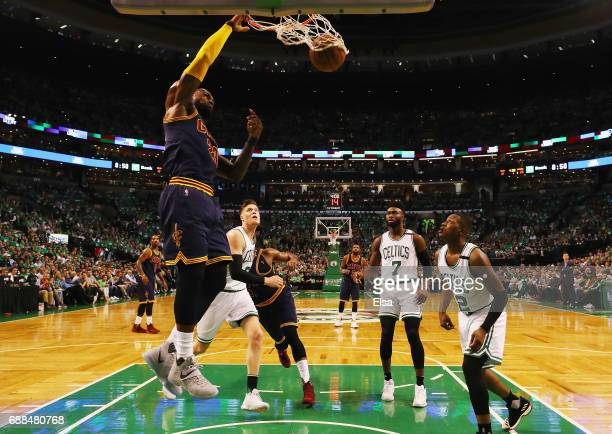 LeBron James of the Cleveland Cavaliers dunks in the first half as Jaylen Brown and Terry Rozier of the Boston Celtics defend during Game Five of the...