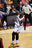 LeBron James of the Cleveland Cavaliers dunks in the second quarter against the Toronto Raptors in game one of the Eastern Conference Finals during...