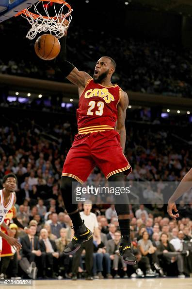 LeBron James of the Cleveland Cavaliers dunks in the second quarter against the New York Knicks at Madison Square Garden on December 7 2016 in New...